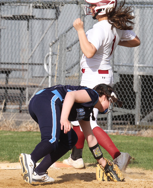Lowell vs Dracut softball. Lowell's Mia Ly (1) is safe at first with an infield single, avoiding tag by Dracut first baseman Kaleigh Brule (5) in the bottom of the fifth inning. (SUN/Julia Malakie)
