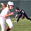Lowell vs Dracut softball. Lowell baserunner Shyanne Greene heads to third after Dracut right fielder Kat Moore (3) couldn't hang onto a fly ball in the bottom of the fifth inning. (SUN/Julia Malakie)