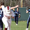 Lowell vs Dracut softball. Lowell baserunner Shyanne Greene heads to third after Dracut right fielder Kat Moore (3) couldn't hang onto a fly ball in the bottom of the fifth inning. Waiting for throw are Amy Lupien (17) and Jill Gomes (29). (SUN/Julia Malakie)
