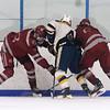 Lowell vs Hanover boys hockey in MIAA tournament. Lowell's Keegan Cote (23) and Nicholas Mandeville(6), and Hanover's Ryan Larvey (4). (SUN/Julia Malakie)