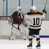 Lowell vs Hanover boys hockey in MIAA tournament. Hanover's Ethan Davis (10) celebrates a goal (not necessarilly his) past Lowell goalie Jake Vieira (1) that gave Hanover a 4-1 lead. (SUN/Julia Malakie)