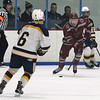 Lowell vs Hanover boys hockey in MIAA tournament. Hanover's Thao Lanagan (6) and Lowell's Ben Kotsifas (7). (SUN/Julia Malakie)