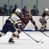 Lowell vs Hanover boys hockey in MIAA tournament. Hanover's Ryan Larvey (4) and Lowell's Owen Goulette (8). (SUN/Julia Malakie)