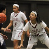 Lowell vs Lawrence girls basketball. Lawrence's Telaisha Solier (3) and Lowell's Latasha Settles (20). (SUN/Julia Malakie)
