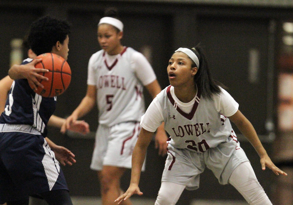 . Lowell vs Lawrence girls basketball. Lawrence\'s Telaisha Solier (3) and Lowell\'s Latasha Settles (20). (SUN/Julia Malakie)