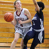 Lowell vs Lawrence girls basketball. Lowell's Sarah Meehan (4) and Lawrence's Telaisha Solier (3). (SUN/Julia Malakie)