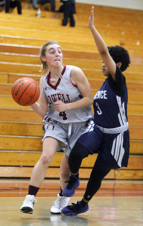 . Lowell vs Lawrence girls basketball. Lowell\'s Sarah Meehan (4) and Lawrence\'s Telaisha Solier (3). (SUN/Julia Malakie)