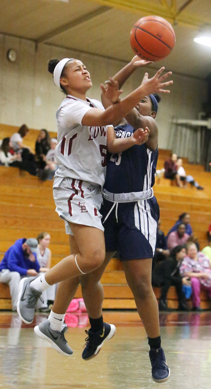 . Lowell vs Lawrence girls basketball. Lowell\'s Shyan Mwai (5) and Jasmine Mejia (23). (SUN/Julia Malakie)