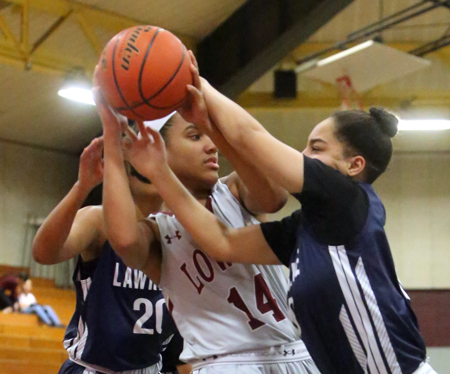 . Lowell vs Lawrence girls basketball. Lowell\'s Yodelis Paulino (14), and Lawrence\'s Lisbeth Carpio (20), left, and Daylis DeLeon (10). (SUN/Julia Malakie)