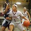 Lowell vs Lawrence girls basketball. Lawrence's Jasmine Mejia (23) and Lowell's Shyan Mwai (5). (SUN/Julia Malakie)