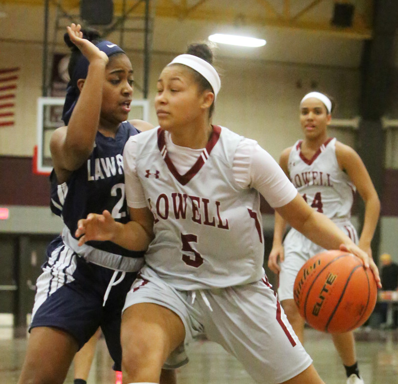 . Lowell vs Lawrence girls basketball. Lawrence\'s Jasmine Mejia (23) and Lowell\'s Shyan Mwai (5). (SUN/Julia Malakie)