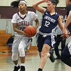 Lowell vs Lawrence girls basketball. Lowell's Latasha Settles (20) and Lawrence's Hailey Gil (12). (SUN/Julia Malakie)