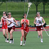 Lowell vs Masconomet girls lacrosse in MIAA tournament first round game.  Lowell's Hannah McAnespie (8), left, and Kaleigh Dunham (9), right, and Masconomet's Jocelyn Dalton (23) and Eva Tveter (16). (SUN/Julia Malakie)