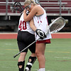 Lowell vs Masconomet girls lacrosse in MIAA tournament first round game.  Lowell's Olyvia Cassella (19), right, hugs goalie Isabella Marsden after Masconomet won, 14-8. (SUN/Julia Malakie)