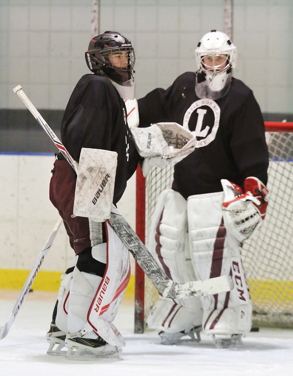 . Lowell High hockey goalies Andrew Carrabis, 16, left, and Patrick Cote, 17, right, both juniors, at practice.  (SUN/Julia Malakie)