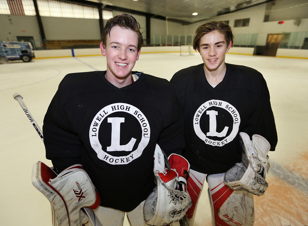 . Lowell High hockey goalies Patrick Cote, 17, left, and Andrew Carrabis, 16 right, both juniors, at practice.  (SUN/Julia Malakie)