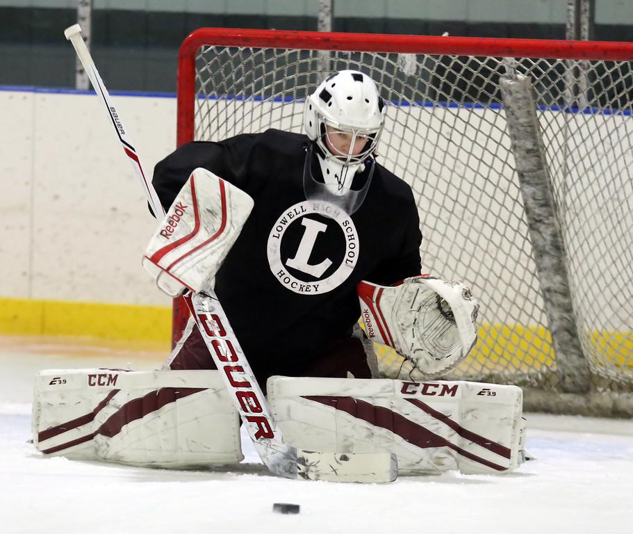 . Lowell High hockey goalies Patrick Cote, 17, a junior, at practice.  (SUN/Julia Malakie)