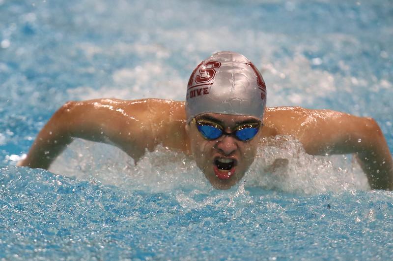 Lowell vs Andover boys high school swimming. Lowell's Jonathan Santos in 100 Butterfly. (SUN/Julia Malakie)