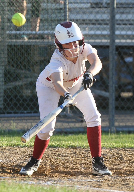 . Lowell vs Boston Latin softball in MIAA tournament. Lowell\'s Mayson Soucy (2) attempts a bunt in the bottom of the fifth inning. (SUN/Julia Malakie)