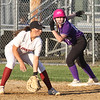 Lowell vs Boston Latin softball in MIAA tournament. Lowell first baseman Mia Ly (1), and Boston Latin baserunner Kate McGrath (19) in the top of the seventh inning. (SUN/Julia Malakie)