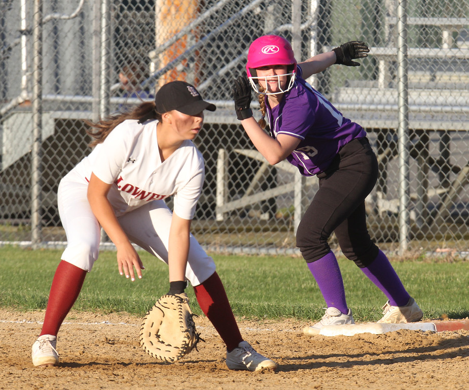 . Lowell vs Boston Latin softball in MIAA tournament. Lowell first baseman Mia Ly (1), and Boston Latin baserunner Kate McGrath (19) in the top of the seventh inning. (SUN/Julia Malakie)