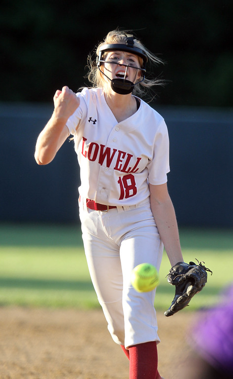 . Lowell vs Boston Latin softball in MIAA tournament. Lowell pitcher Giana Lacedra (18) in top of seventh. (SUN/Julia Malakie)