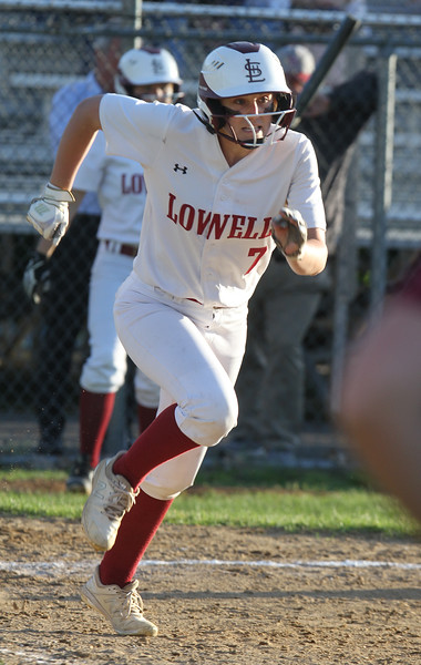 Lowell vs Boston Latin softball in MIAA tournament. Lowell's Laura Heslin (7) runs out a ground ball out in the bottom of the fifth inning. (SUN/Julia Malakie)