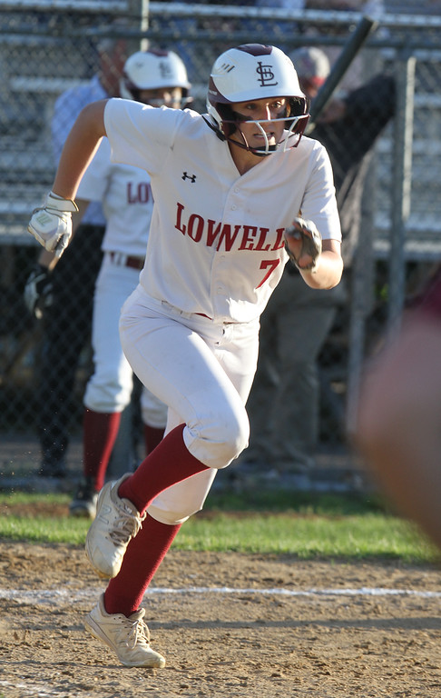 . Lowell vs Boston Latin softball in MIAA tournament. Lowell\'s Laura Heslin (7) runs out a ground ball out in the bottom of the fifth inning. (SUN/Julia Malakie)