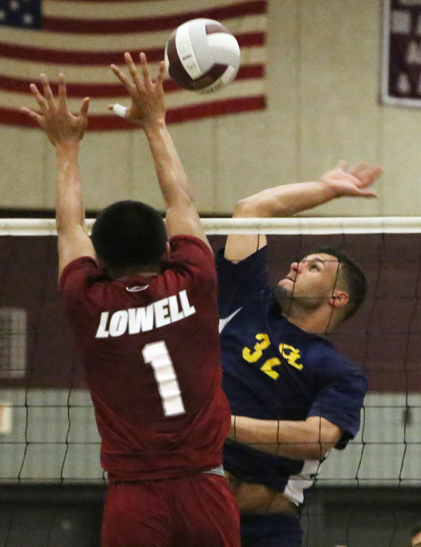 . Lowell vs Greater Lowell boys volleyball. Lowell\'s Buth Ly (1) and Greater Lowell\'s Jimmy Raposa (32). (SUN/Julia Malakie)