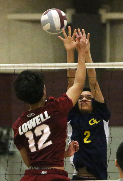 . Lowell vs Greater Lowell boys volleyball. Lowell\'s Julien Tang (12) and Greater Lowell\'s Joseph Pacheco (2). (SUN/Julia Malakie)