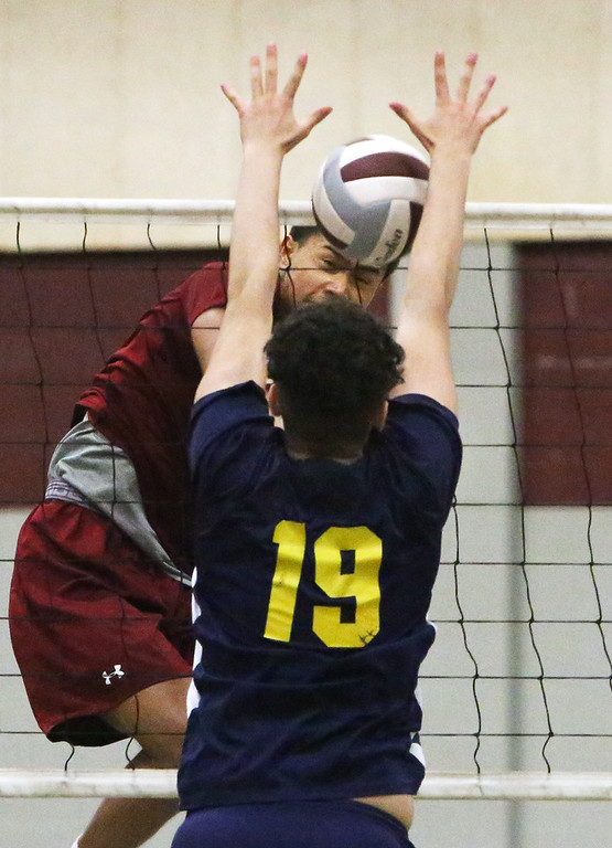 . Lowell vs Greater Lowell boys volleyball. Lowell\'s Buth Ly (1) and Greater Lowell\'s Matthew Medina (19). (SUN/Julia Malakie)