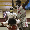 Lowell vs Haverhill boys basketball. Lowell's George Turkson (45) and Haverhill's Angel Burgos (3). (SUN/Julia Malakie)