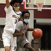 Lowell vs Haverhill boys basketball. Haverhill's Angel Burgos (3) and Lowell's Jaceb McKenzie (2). (SUN/Julia Malakie)