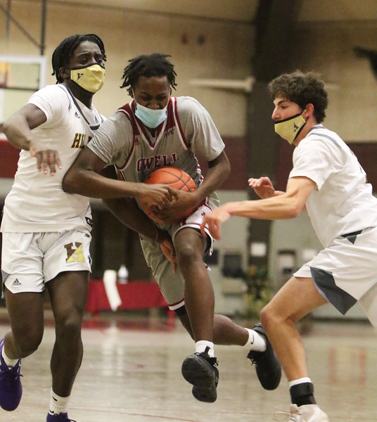 Lowell vs Haverhill boys basketball. Haverhill's Phillip Cunningham (1) and Zachary Guertin (13), right, and Jaceb McKenzie (2). (SUN/Julia Malakie)