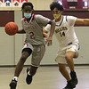 Lowell vs Haverhill boys basketball. Lowell's Jaceb McKenzie (2) and Haverhill's Enrique Alvarado (14). (SUN/Julia Malakie)