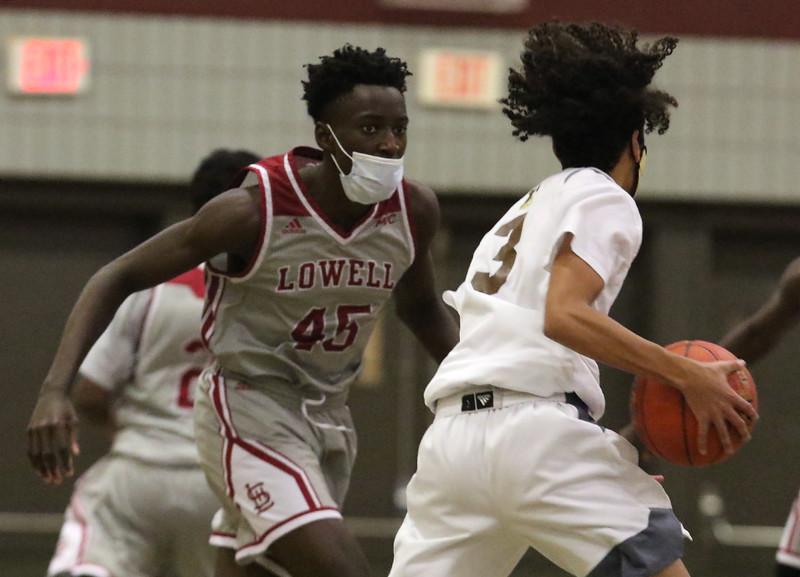 Lowell vs Haverhill boys basketball. Lowell's George Turkson (45) and Haverhill's Angel Burgos (3). (SUN/Julia Malakie)