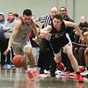 Lowell vs Lowell Catholic boys basketball in MIAA tournament game. Lowell's Carlos Nunez Jr (3) and Central Catholic's Nate Godin (24).  (SUN/Julia Malakie)