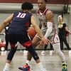 Lowell vs Lowell Catholic boys basketball in MIAA tournament game. Central Catholic's Jonathan Peguero (10) and Lowell's Nathaniel Siow (4). (SUN/Julia Malakie)