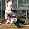Lowell vs Lowell Catholic softball. Lowell's Mia Ly (1) gets back safely to first as throw gets by Lowell Catholic first baseman Megan Murphy (14) in the bottom of the second inning. (SUN/Julia Malakie)
