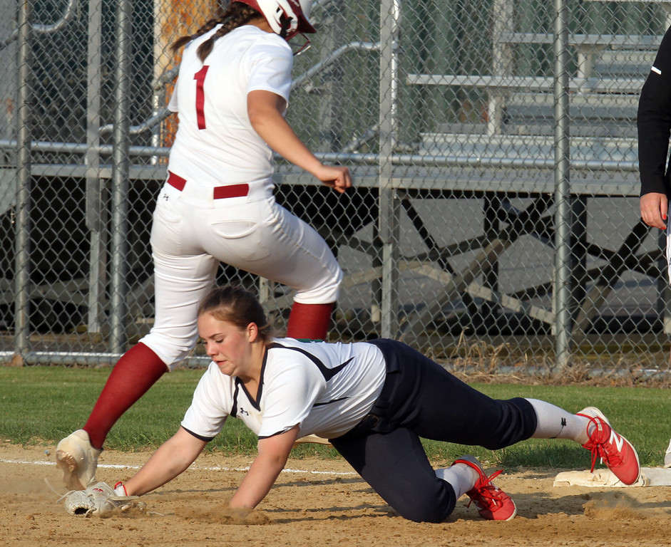 . Lowell vs Lowell Catholic softball. Lowell\'s Mia Ly (1) gets back safely to first as throw gets by Lowell Catholic first baseman Megan Murphy (14) in the bottom of the second inning. (SUN/Julia Malakie)