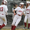 Lowell vs Westford Academy softball. Lowell's Erin McPhee (13) and Shyanne Greene (16) score on a single by Laura Heslin in the bottom of the third innig. On deck is Mayson Soucy (2).  (SUN/Julia Malakie)