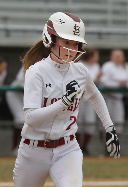 Lowell vs Westford Academy softball. Lowell's Mayson Soucy (2) singles in bottom of second inning. (SUN/Julia Malakie)