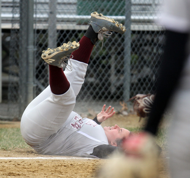 Lowell vs Westford Academy softball. WA third baseman Gigi Ottaviano (24) falls backward after going after a foul ball in the bottom of the third inning. (SUN/Julia Malakie)