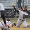 Lowell vs Westford Academy softball. WA third baseman Gigi Ottaviano (24) throws to first on a ground ball as pitcher Emily Strzegowski (15) ducks, for the final out of the bottom of the third inning on a ground ball. (SUN/Julia Malakie)