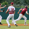 Lowell vs BC High in MIAA baseball Division 1A tournament. Lowell third baseman Tyler Hoey (7) throws to second and pitcher Timothy Scott (9) watches as BC High's Pat Roche (19) is caught in a rundown between second and third in the top of the first inning. (SUN/Julia Malakie)