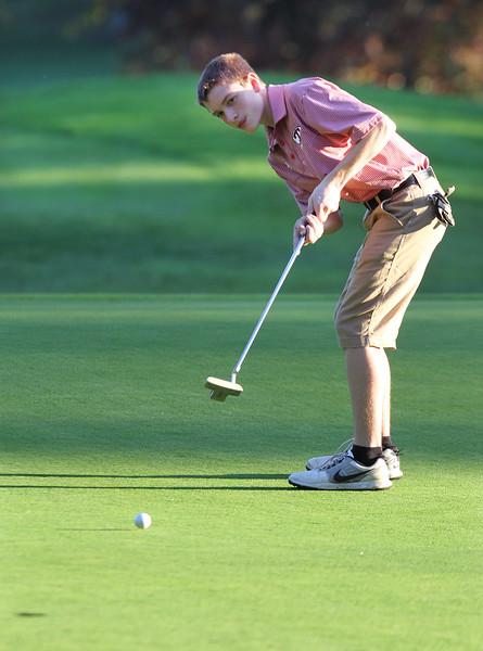 Lowell vs Tyngsboro golf. Tyngsboro's Josh Savoie putts on 7th hole. (SUN/Julia Malakie)