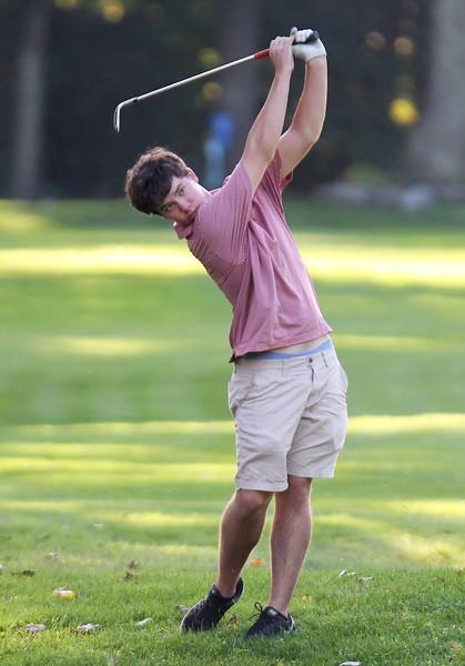 Lowell vs Tyngsboro golf. Tyngsboro's Kevin Carpenter hits from the 5th fairway. (SUN/Julia Malakie)