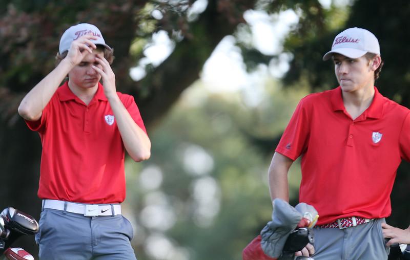 Lowell vs Tyngsboro golf. Lowell's Owen Goulette, left and Trevor Green. (SUN/Julia Malakie)