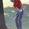 Lowell vs Tyngsboro golf. Lowell's Owen Goulette hits from behind a tree on the 5th hole. (SUN/Julia Malakie)