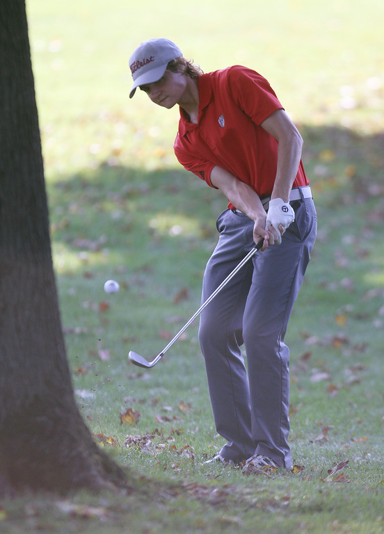 . Lowell vs Tyngsboro golf. Lowell\'s Owen Goulette hits from behind a tree on the 5th hole. (SUN/Julia Malakie)